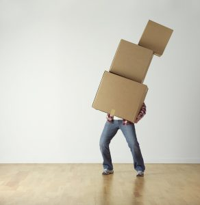 Pack your clothes in cardboard boxes, just like the man in this picture did.