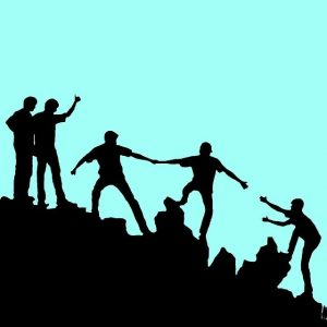 A drawing of people climbing a mountain by holding hands together.
